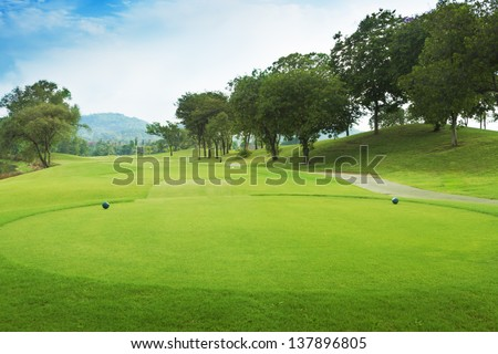 golf course from tee off green. - stock photo