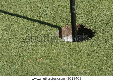 Golf Course - Hole On Green Grass With Flog, Background - stock photo