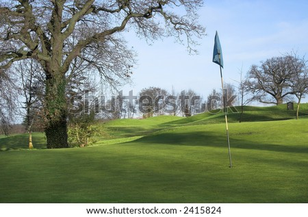 golf course in morning winter sunshine (long shadows) - stock photo