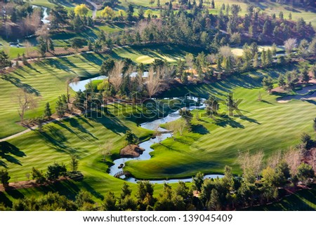Golf course in the morning - stock photo