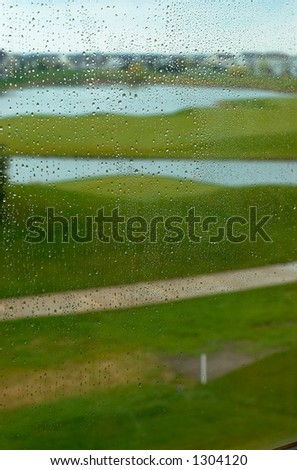 Golf course in the rain. This image has more rain drops but more clear background view. Can also be a nice background image. This is a photo from A Raining Day Collection. Search keyword Series005