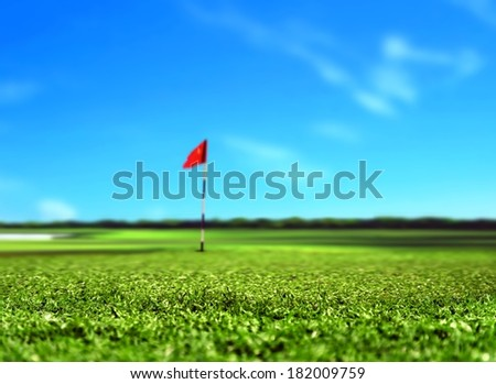 Golf Course Landscape with Red Flag  - stock photo