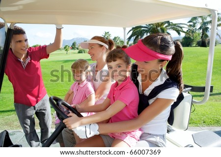 golf course mothers and daughters in buggy talking father - stock photo