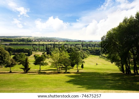 Golf course on a beautiful summer day - stock photo