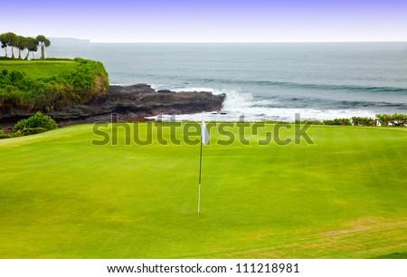 Golf course on an ocean coast - stock photo