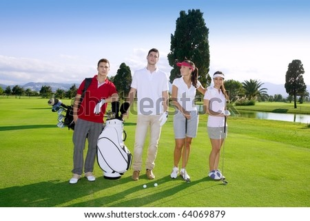 Golf course people group young players team grass field - stock photo