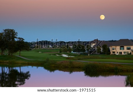 Golf course & pond under the moon. More with keyword group1a