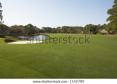 golf course putting green with sand trap - stock photo