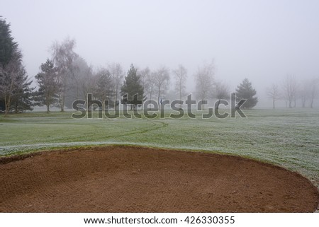 Golf course sand bunker on a cold and misty day - stock photo