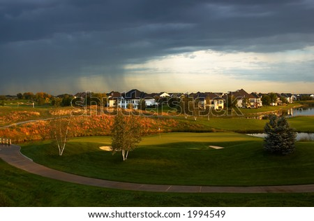 Golf course under the stormy sky. More with keyword group1a