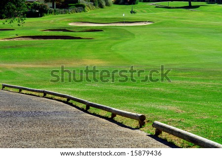Golf course whit green at the top - stock photo