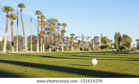 Golf course white balls spread all over grass in Encanto par, Phoenix downtown, Arizona in Winter; Copy space