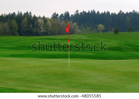Golf course with fresh green grass
