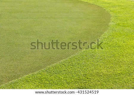 Golf course with gorgeous green. green grass background in golf course. Golf Courses green lawn. golf curve. Green Grass texture,golf course. grass background. Green grass background texture.
