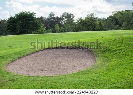 golf course with sand bunker and green grass - stock photo