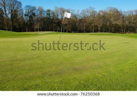 golf course with white flag - stock photo