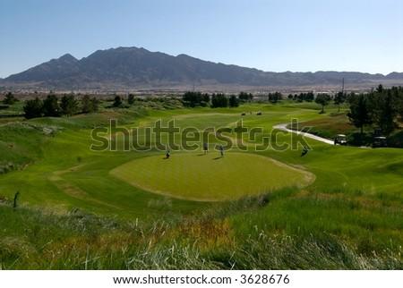 Golf couse in desert - stock photo