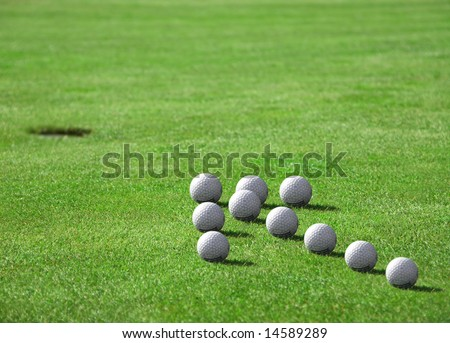 Golf - detail ball with hole on green - stock photo