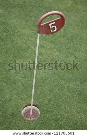 Golf drive range mark. Golf drive range mark number 5 - stock photo