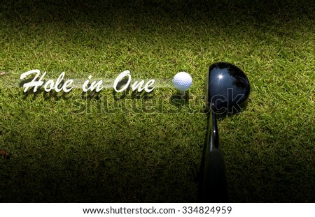 Golf driver driving ball with Hole-in-One caption - stock photo