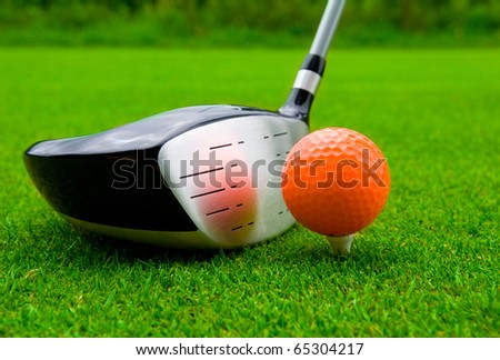 Golf driver with orange ball. - stock photo