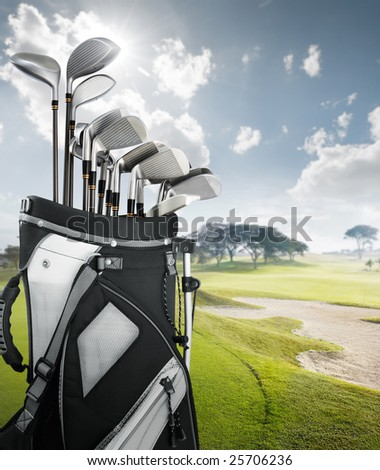 golf equipment at the course on sunny day - stock photo