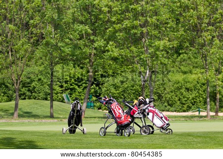 golf equipment is standing on the golf course