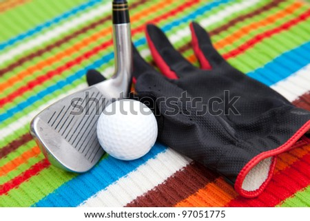 Golf equipment on colourful background - stock photo