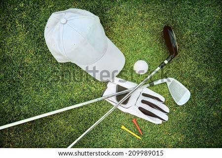 Golf equipment on green grass - stock photo