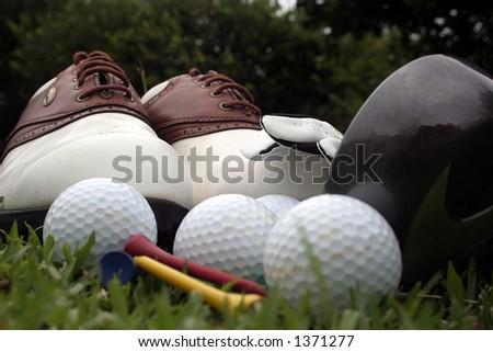 Golf equipment on the fairway - stock photo