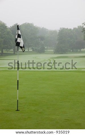 Golf flag in early morning - stock photo