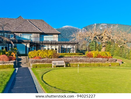 Golf flag on beautiful golf place with a fantastic mountain view. - stock photo