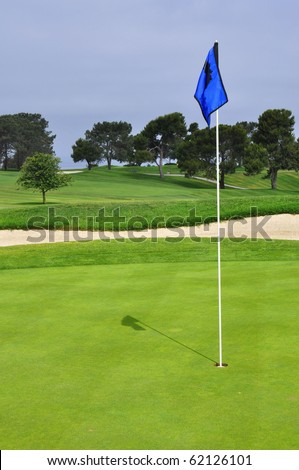 Golf flag on green, room for your text - stock photo