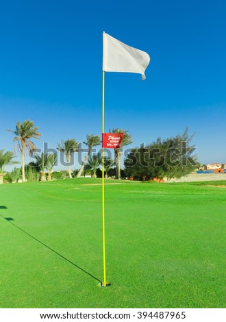 Golf Flag Stirred By The Wind  - stock photo