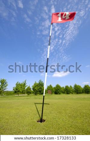 Golf flag. Taken on a warm summer day. - stock photo
