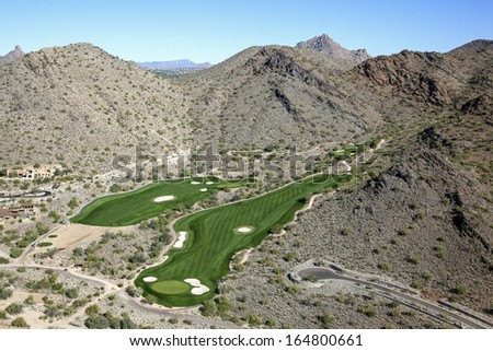 Golf Greens in the McDowell Mountains, Scottsdale, Arizona - stock photo