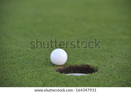 golf hole close up for ideal putt - stock photo