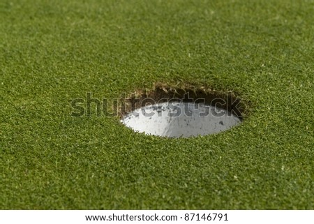 golf hole on green in sunny ambiance - stock photo