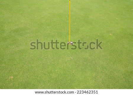 Golf hole on the green grass - stock photo