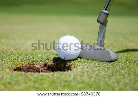golf hole with ball and putt - stock photo