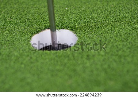 Golf hole with green grass.