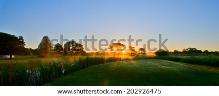 Golf in the morning mist. - stock photo