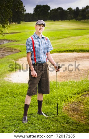 Golf Is The Sport See A Happy Man Standing Outside On A Green Grassy Golf Fairway During Daylight Holding A Golfing Stick Ready To Play A Game Of Sporting Fun