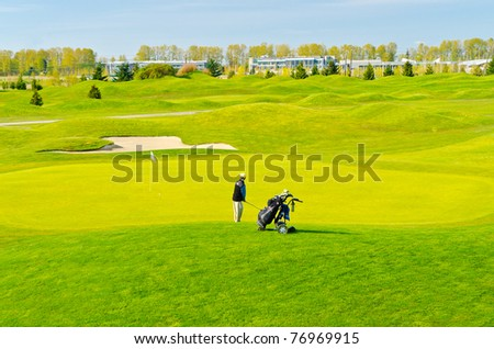 Golf place with gorgeous green and nice view. - stock photo