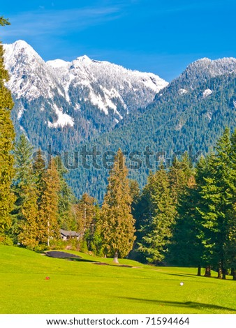 Golf place with nice green and gorgeous mountain view.