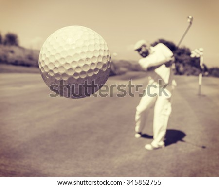 Golf player at club - stock photo