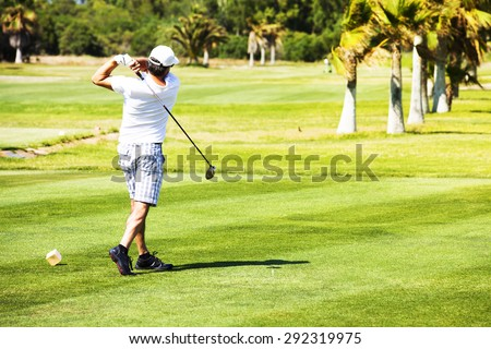 Golf player hit from the tee start at a golf course.
