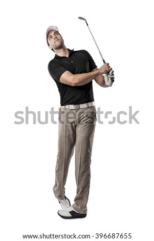 Golf Player in a black shirt taking a swing, on a white Background. - stock photo
