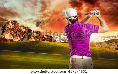 Golf Player in a pink shirt taking a swing, on a golf course.