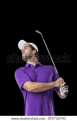 Golf Player in a purple shirt taking a swing, on a black Background.